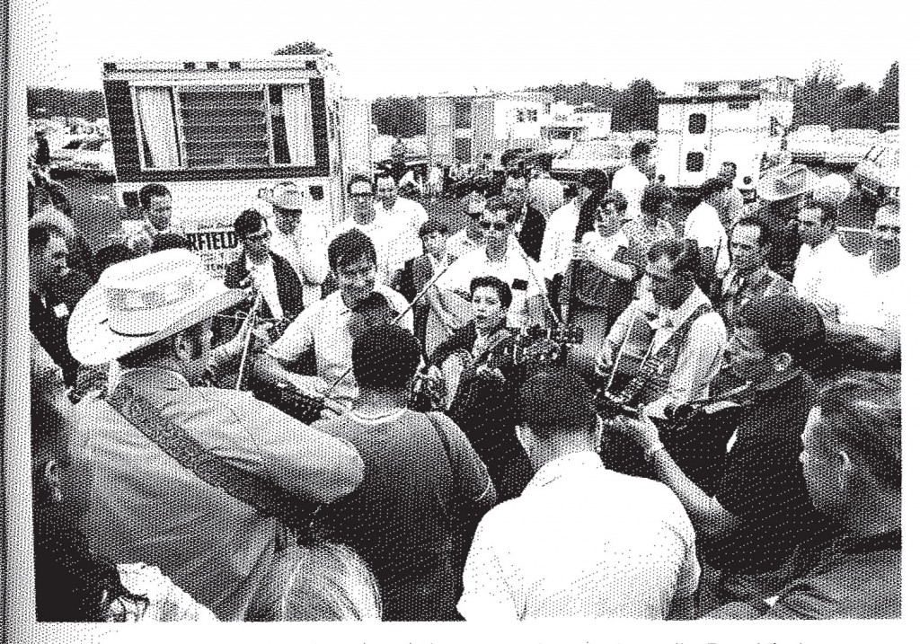 David DeJean, photograph of jam session in Jamboree parking lot, 1969, in Thomas Adler, Bean Blossom: The Brown County Jamboree and Bill Monroe's Bluegrass Festivals